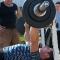 Спортсмены жмут штангу собственного веса